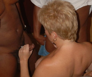 Horny mature Dee Delmar loves a gangbang and eagerly slurps interracial cum