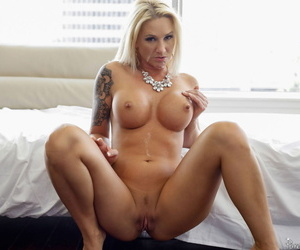 Sexy blonde with big tits Alexis Malone rides a thick cock during daytime sex