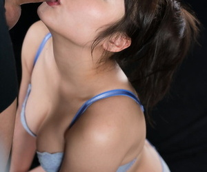 Japanese girl in her bra and panty ensemble licks cum from lips after a BJ