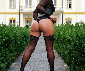 Smoking hot cougar Sandra Romain flashes her pussy and exposes her amazing ass