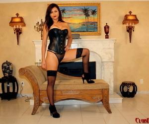 Marvelous femdom in black corset and heels Penelope milks her slaves dick