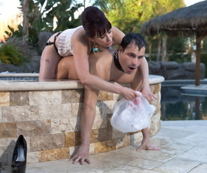 Strict Maitresse Madeline Marlowe analyzes her slave with strapon in pool