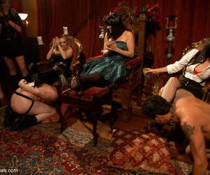 Four dominant MILFs torture two submissive dudes at the BDSM party