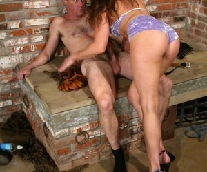 Dominatrix Kym Wilde tops male sub Wild Bill in halter top and shorts