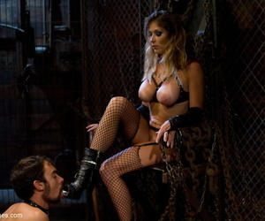 Hot blonde in fishnets and boots has her male sub lick her asshole clean