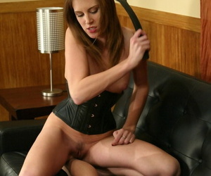 Topless dominatrix Audrey Leigh beats naked male subs feet & ass with paddle