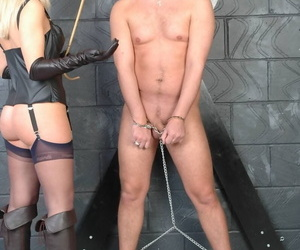 Nice blonde Belle has her way with a cuffed and naked male in leather