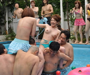 Japanese beauties lose their bikinis during wrestling match in a swimming pool