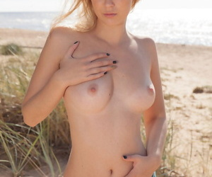 Casey enjoys the summer sun hard by basking undress and masturbating all over the beach - part 788