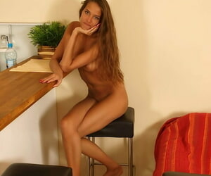Cute teen Silvie Deluxe revealing her svelte body and exposing her bare feet