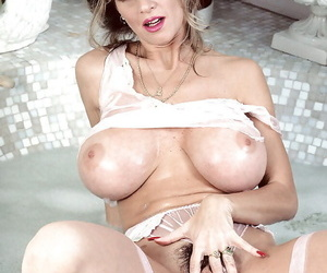 Wet adult blonde babe Busty Out-moded unveils huge hooters and hairy pussy