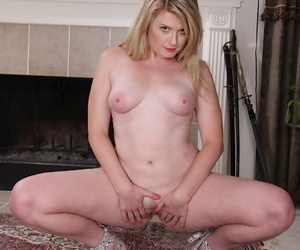 Mature blonde Lexi Moore undresses in the kitchen like a sexy babe