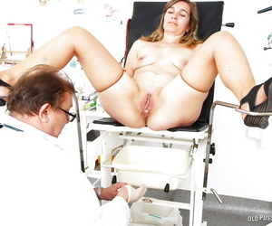 Mature woman Lamacka having speculum inserted into spread pussy