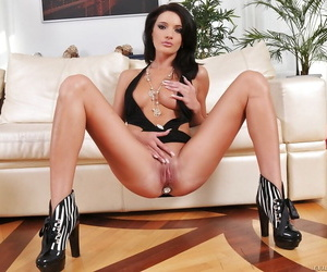 Slim babe with long legs Milla Yul posing with a toy into her asshole