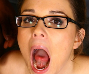Nerdy white girl undresses before sucking off a black man