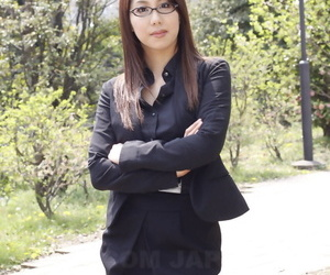 Japanese model Hikaru Matsu takes her glasses on and off in business clothing