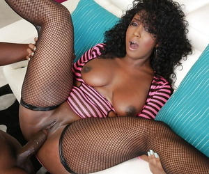 Shaved pussy of an Ebony brunette Layton Benton fucked in stockings