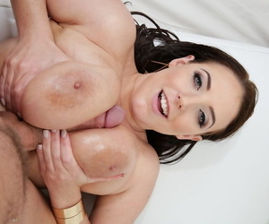 MILF pornstar Angela White gets all oiled up before doing anal sex
