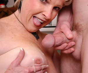 Stocking attired granny Perfect example taking cumshot on high jugs in pantry