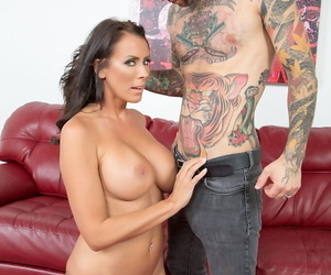 Mature pornstar Reagan Foxx gets fucked hard on a red leather couch