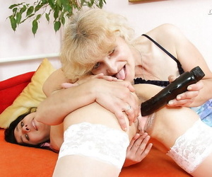 Experienced lesbians close to stockings increased by heels licking ass increased by vaginas