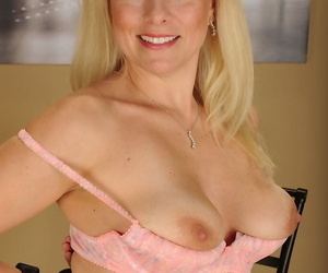 Experienced blonde woman Zoey Tyler stripping down to her bra and underwear