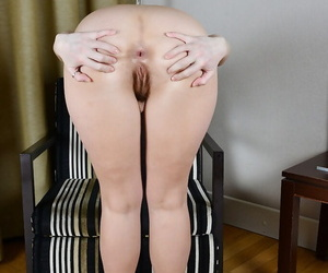 Leggy older broad Mischelle modeling in high heels while flashing ass
