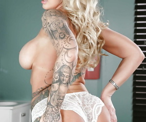 Tattooed older blonde Ryan Conner akin gone bare ass with the addition of large tits