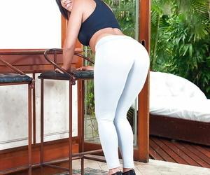 Brunette Latina MILF Sara Rosar sliding yoga pants over big booty