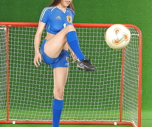 Foxy asian teen with hot irritant poses in conclave painted soccer equipment