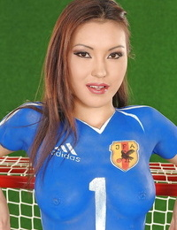 Foxy asian teen with hot ass poses in body painted soccer outfit