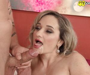 Mature Amelie Azzure throats cock until the last drop of jizz