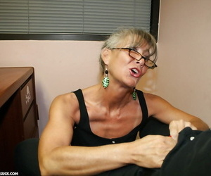Mature secretary in glasses gives a great blowjob to her boss