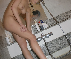 Seductive asian babe with bushy cunt stripping and taking bath