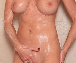Busty mature broad Jade Jamison masturbating shaved pussy in clear out