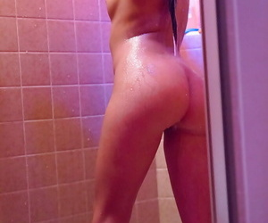 Barely legal hottie soaping up small tits and shaved cunt in shower