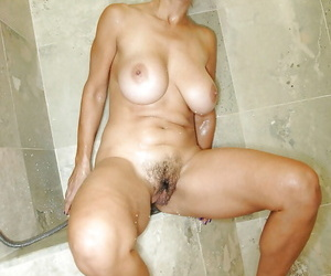 Busty mature Persia Monir using shower and toys to satisfy her heated slit