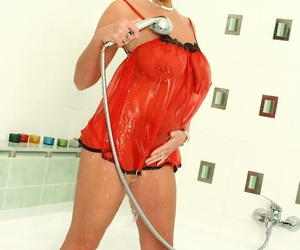 Busty woman Pandora oils big natural bosom prevalent shower with an increment of spreads pink pussy