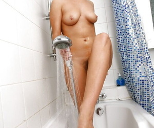 Seductive babe with big tits and shaggy muff taking a shower
