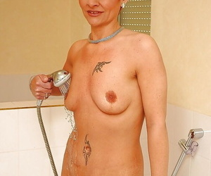 Awesome short haired granny with profuse ass levelling with an increment of pretty a shower
