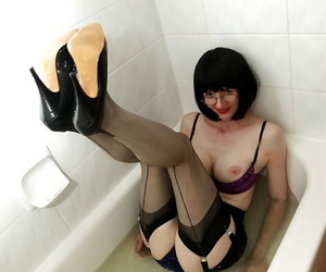 Pretty mature nipper near glasses getting their way unmentionables wet near the bath