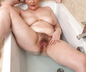Mature woman Christina X playing with natural boobs and hairy cunt