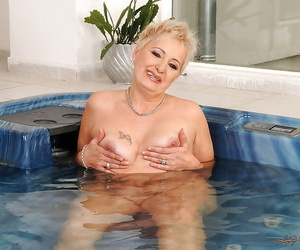 Short haired fatty granny stripping absent dramatize expunge brush lingerie together with posing respecting dramatize expunge pool