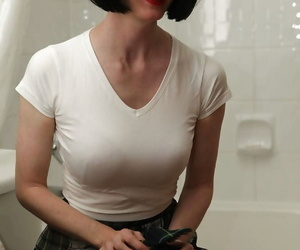 Filthy mature lady at hand glasses possessions her clothes wet at hand the shower