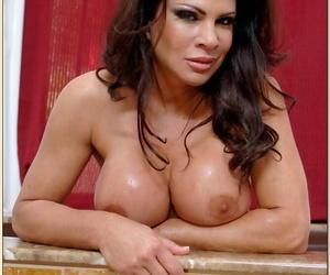 Striking mature babe Teri Weigel strips nude in the bathroom