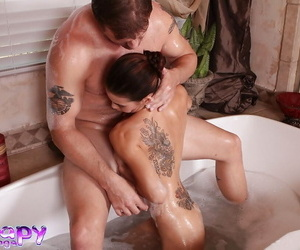 Tattooed masseuse with graceful curves gives a soapy blowjob to her client