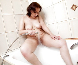 Rotundity beamy titted Alena masturbating together with dissemination pussy in the shower