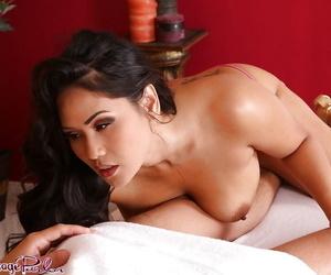 Curvy brunette masseuse Jessica Bangkok getting naked to deliver handjob