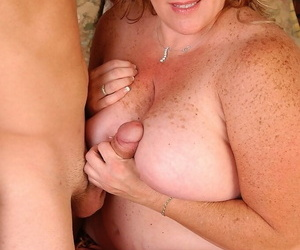 Freckled grown-up fatty Deedra eating sperm after giving a titjob