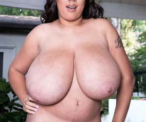 Solo model Milly Marks rocks her monster sized boobs for centerfold shoot